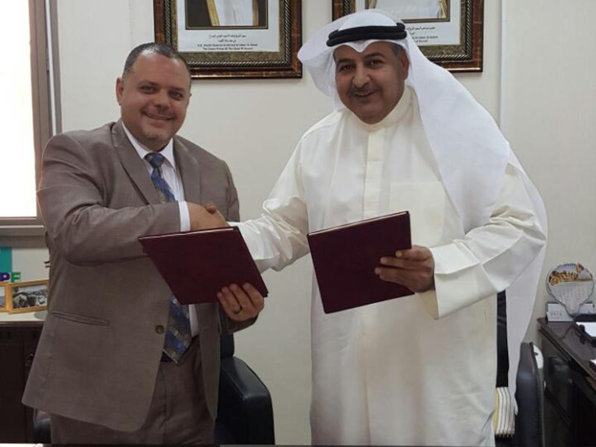 """The Public Authority of Manpower in Kuwait signs a new contract """"The Automation"""" with the National Technology Enterprises Company"""